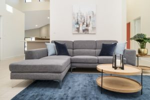 modern designed living area with L shaped sofa